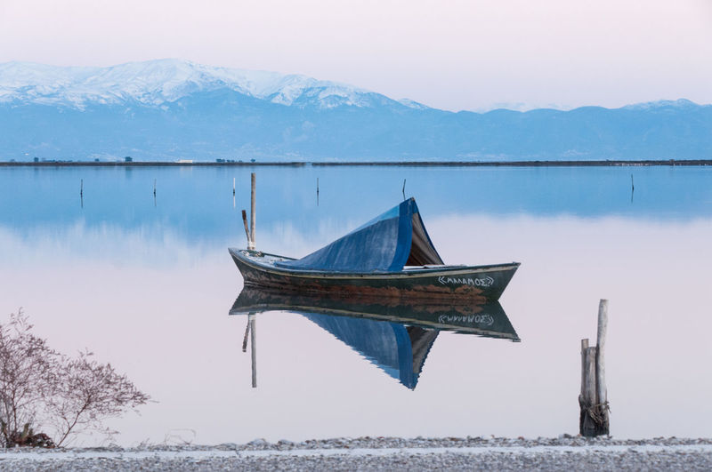 Hellas Reflection Reflejo Winter Wood Agua Beauty In Nature Blue Boat Cold Temperature Day Mountain Nature No People Outdoors Sea Sky Snow Tranquil Scene Tranquility Water