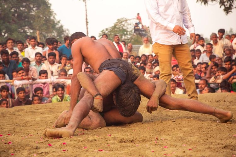 Dangal, also known as Kushti, is an Indian form of wrestling played in mud. It is still popular form of entertainment and spoort in smaller towns and villages in India. Pictured here is a local competition held in a popular fair in Deva, Barabanki, India. Dangal India Indian Wrestling Kushti Sports Street Photography Streetphotography The Street Photographer - 2017 EyeEm Awards Wrestling