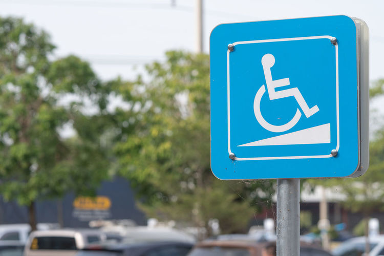 Blue accessibility sign in city