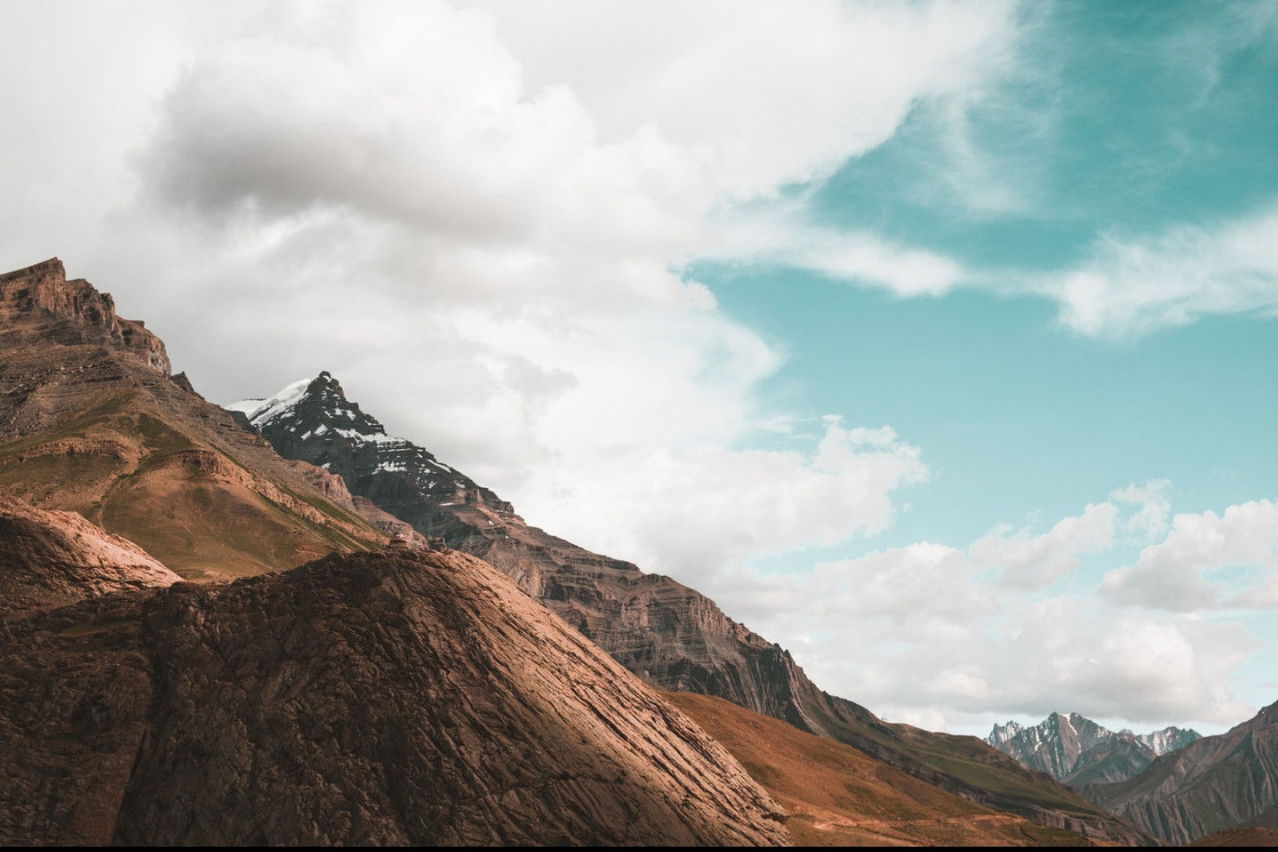 mountain, sky, cloud - sky, beauty in nature, environment, scenics - nature, nature, mountain range, landscape, no people, rock, tranquil scene, non-urban scene, tranquility, day, mountain peak, land, formation, travel, scenery, high, range, eroded, height