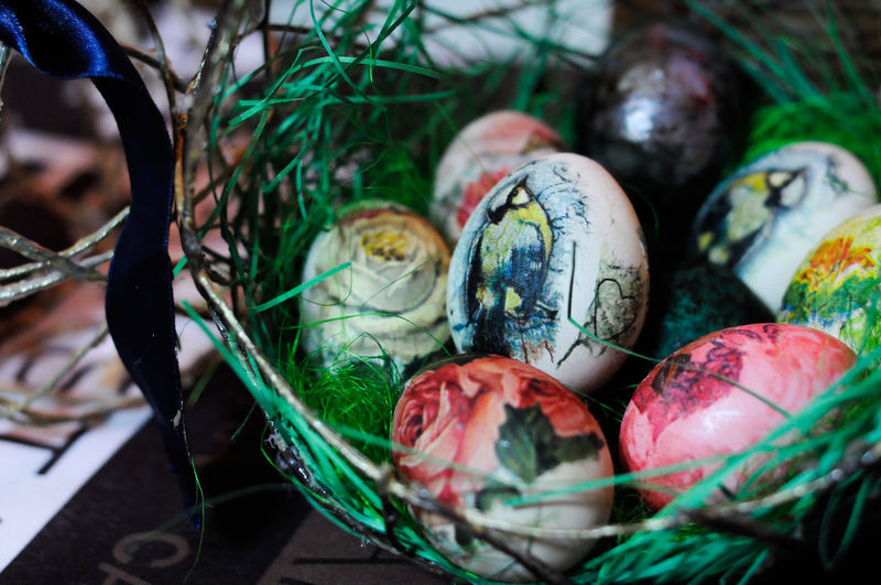 Close-Up Of Multi Colored Decorated Easter Eggs On Basket