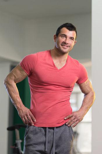 Portrait of smiling man standing indoors