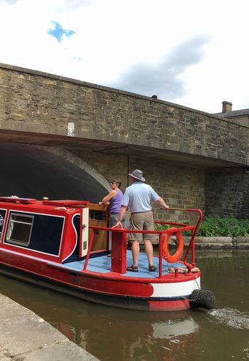 People boating heading to the Leeds Liverpool canal in Skipton, Yorkshire Bridge United Kingdom England Skipton Town Lifestyle Peaceful Transport Barge Leeds Liverpool Canal Yorkshire Canal Boat Trip Water Nautical Vessel Transportation Mode Of Transportation Day Real People River Adult People Outdoors