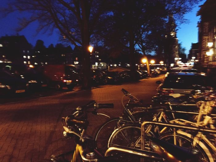 Transportation Bicycle Land Vehicle Mode Of Transport Night Street Illuminated Car City Road Outdoors No People Stationary Architecture Building Exterior Motorcycle Tree Sky Amsterdam Amsterdamcity