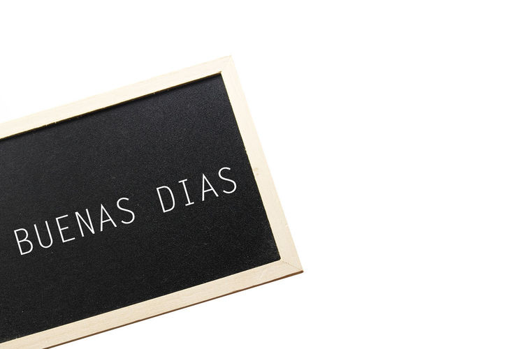 Buenas Dias Buenas Días!  Black Color Blackboard  Blank Board Close-up Communication Copy Space Cut Out Education Indoors  Message No People Personal Organizer Reminder Slate - Rock Studio Shot Text To Do List Western Script White Background White Color