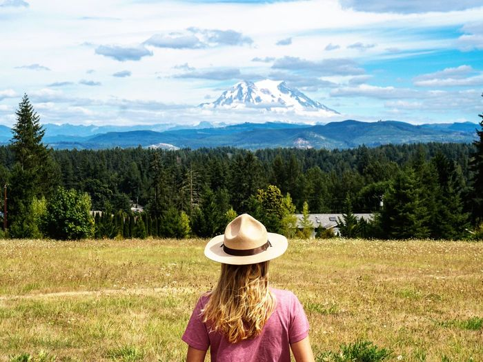 Rear View Of Young Woman In Hat Against Mountains
