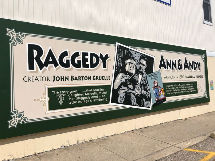 Painted Raggedy Ann Raggedy Andy Mural Art Text Communication Western Script Sign Architecture Day Sunlight Building Exterior Built Structure Wall - Building Feature Outdoors Creativity Street Art Nature Information Art And Craft No People