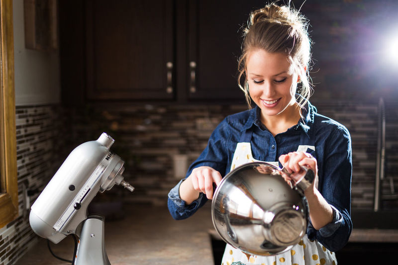 Blond Hair Day Happiness Holding Indoors  Kitchen Kitchen Aid Muffin One Person People Real People Smiling Smiling Face Workshop Young Adult Young Women