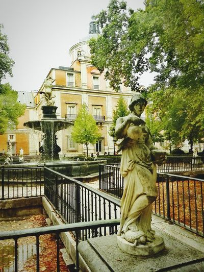 J.J.D.R. Tree City Outdoors Architecture Built Structure Building Exterior Statue Adult Travel Destinations Low Angle View Palacio De Aranjuez Water