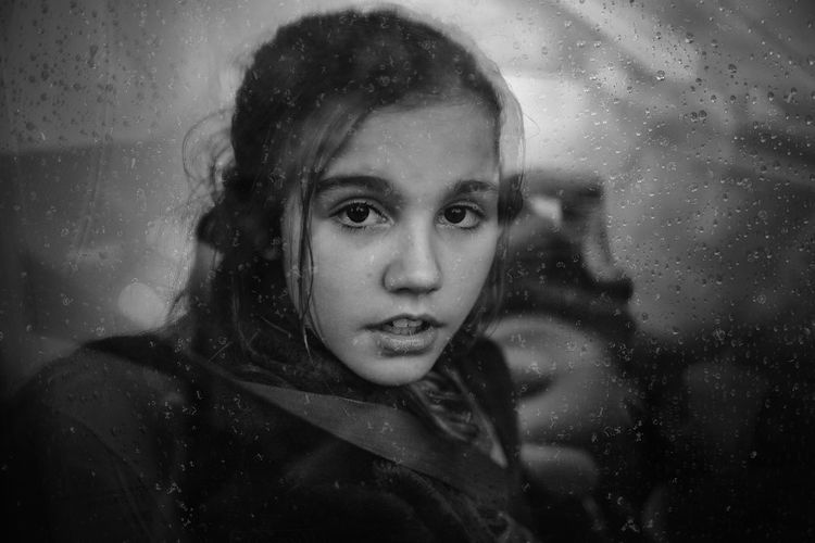 Close-up portrait of woman in rain