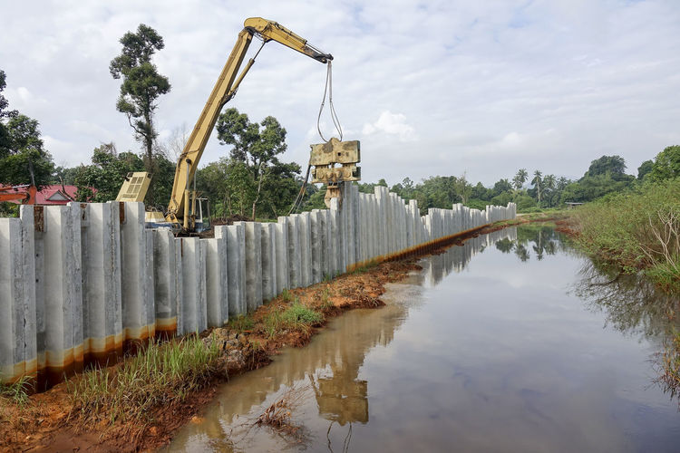COFFERDAM RETAINING WALL INSTALLATION. Channel Industry Machinery Architecture Bridge Construction Built Structure Cofferdam Retaining Wall Concrete Wall Day No People Outdoors Piling Machine Piling Works
