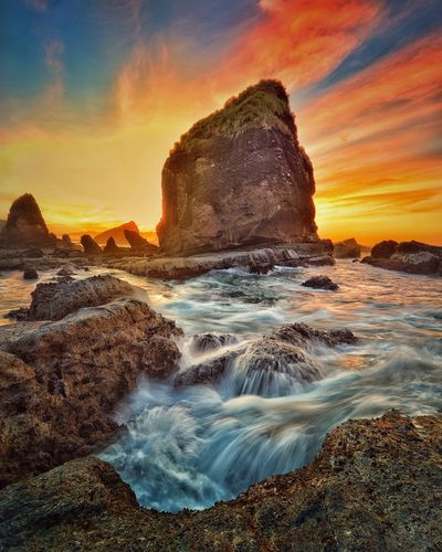 Swerly beach papuma sunrise Wave Water Sea Sunset Beach Astronomy Rock - Object Sand Sky Horizon Over Water Tide Stack Rock Headland Rock Formation Coastal Feature Rocky Coastline Low Tide Geology Natural Arch Rocky Mountains Rock Rugged Rock Hoodoo Physical Geography Coast Seascape Eroded Cliff Surf