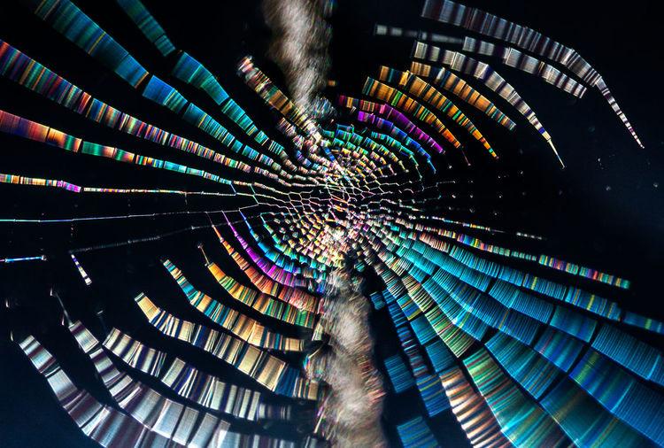 Digital composite image of illuminated ferris wheel