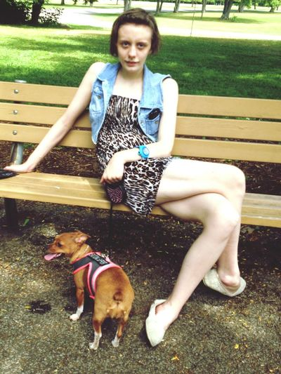 A teenager and her therapy dog taking a break from a walk in the park. Relaxing Enjoying Life Hanging Out Walk In The Park Summer Dogs Summer Memories 🌄 Summer Fun Teenager Young And Beautiful First Eyeem Photo