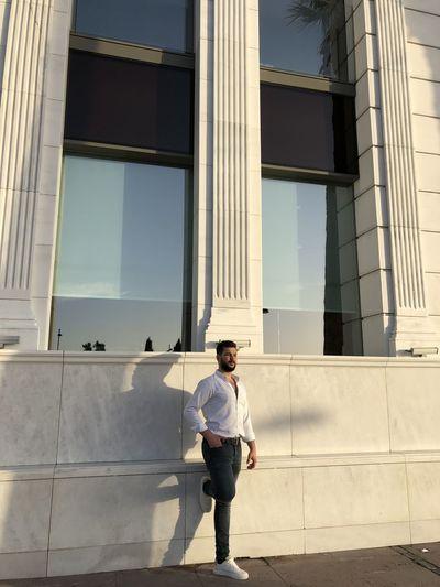 Full length of man standing in modern building