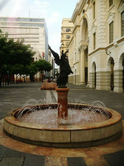 Fountain Splashing Water Statue Drinking Fountain Spraying Travel Destinations Sculpture Sprinkling City Tree Outdoors No People Representing Sky Day