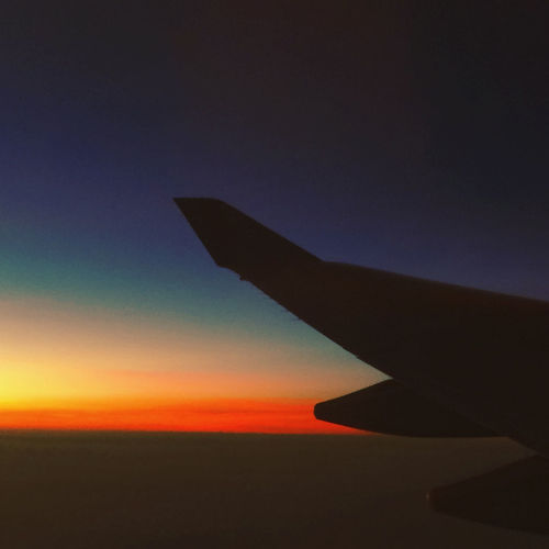 Dusk Sky Aircraft Wing Airplane Airplane Wing Beauty In Nature Dusk Dusk Colours Flight Flightview Flying Gradation Gradation Sky Gradationcolor Journey No People Sky Sunset Transportation Window In The Sky