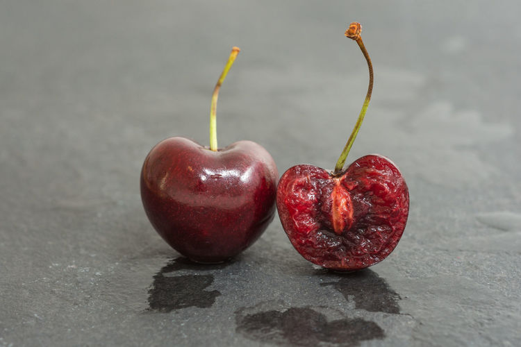 Two sweet cherries in closeup Cherries Dessert Divided Birds Bite Cherry Close-up Closeup Differently Food Freshness Fruit Fruity Gray Background Half Plant Stem Red Ripe Still Life Stone Sweet Symbol Vitamin Wellbeing Wet