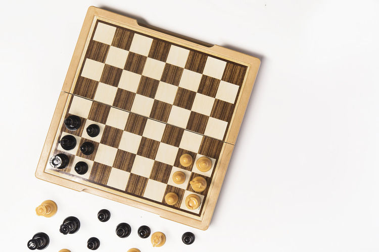 High angle view of chess board against white background