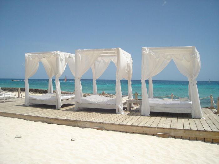Seats Arranged At Boardwalk At Beach Resort