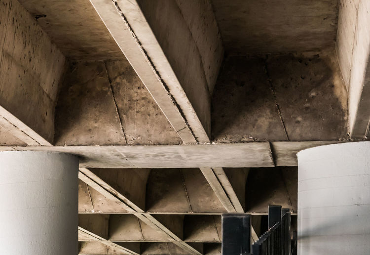 View of the underside of a concrete car ramp. Architectural Column Architecture Backgrounds Bridge Built Structure Ceiling Concrete Connection Day Directly Below Full Frame History Indoors  Low Angle View Metal No People Old Pattern The Past Transportation Underneath Wood - Material A New Perspective On Life