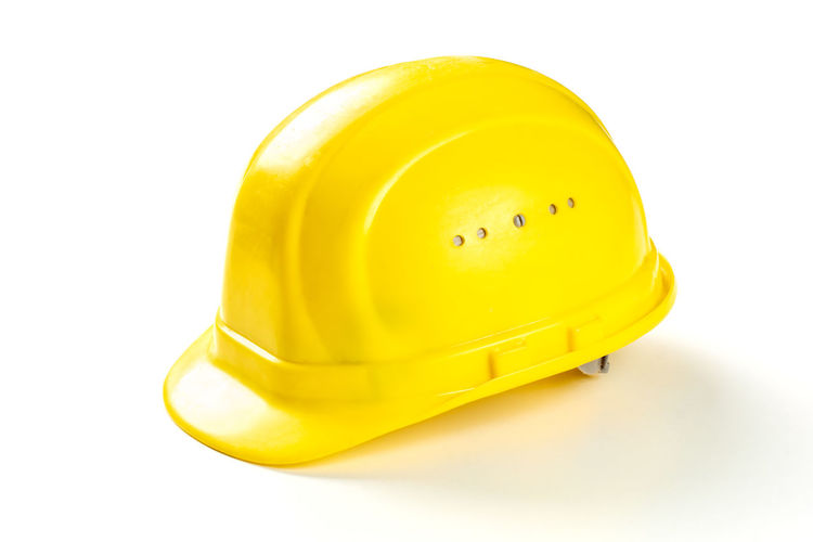 Close-up of yellow hat against white background