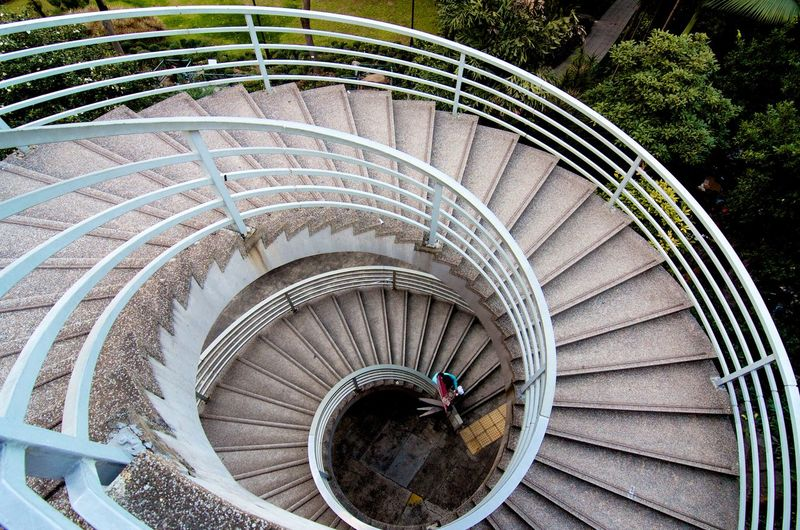 By Sony A7R. People Hong Kong Central ASIA Staricase Building Top View Hk Steps And Staircases Staircase High Angle View Steps Architecture Day Built Structure Outdoors No People Spiral Staircase Tree