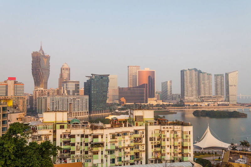 Holiday in Macao - Macau Metropolitan view during sunset Architecture ASIA Asian  Building Exterior Casino China City City Life Cityscape Day Downtown District Gambling Grand Lisboa Macau Macau Tower Macau, China Metropolitan Modern No People Outdoors Sky Skyscraper Town Travel Destinations Urban Skyline