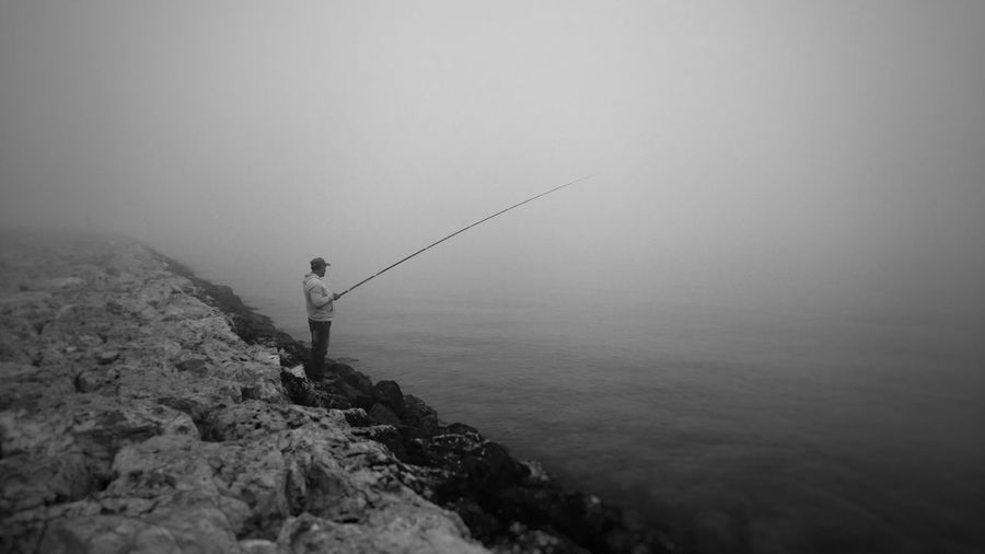 Serenity Nature_collection Serenity Fog Foggy Morning Winter Solstice Athlete Full Length Standing Fishing Tackle Fishing Adventure Fog Holding Fishing Rod Fishing Pole Fisherman Fishing Hook Calm Fishing Equipment Horizon Over Water Catch Of Fish