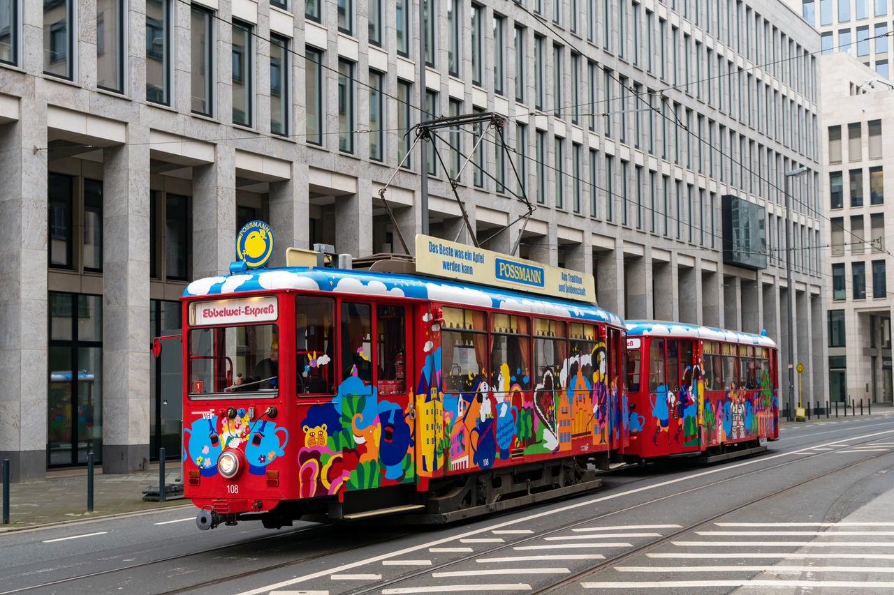 transportation, architecture, road, day, built structure, multi colored, outdoors, building exterior, city, no people