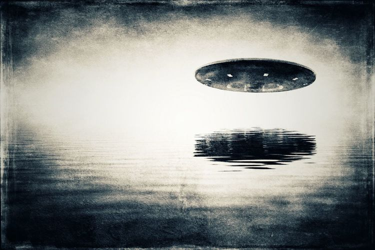 UFO over water UFO Alien Alien Invasion Close Encounters Invaders Invasion Vision Eerie Fantasy Space Threatening Threat Dark Water Reflected  Reflection Flying Saucer Hovering Visitors Sighting Encounter Close Encounter Visitation SpaceShip Visit