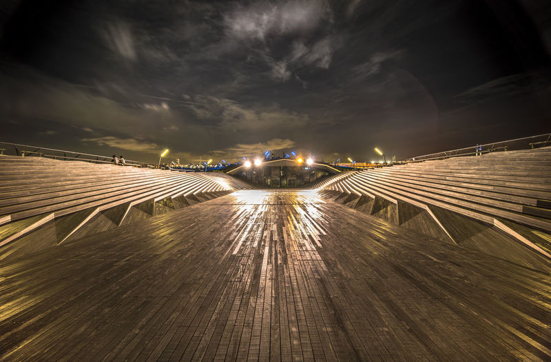 Illuminated osanbashi wooden deck at night in yokohama.