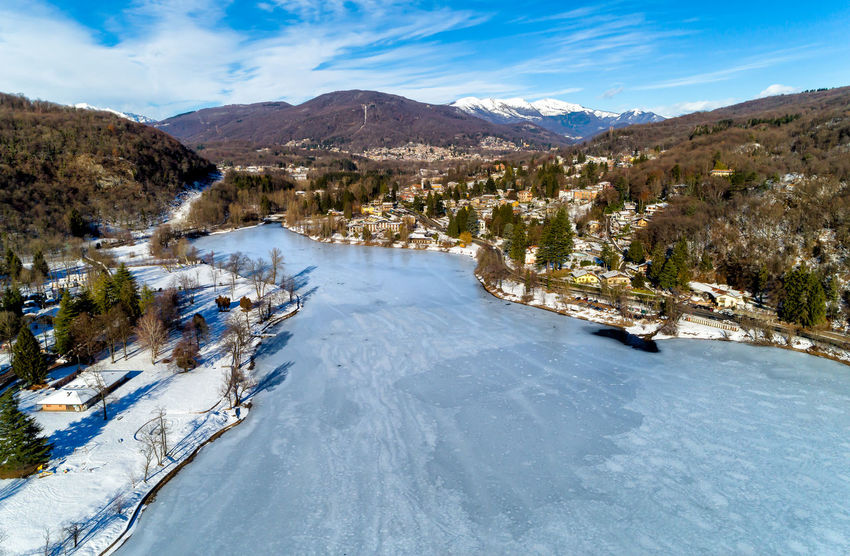 Aerial view of winter landscape of frozen lake Ghirla in province of Varese, Italy. Landscape Photography Valganna Aerial View Beauty In Nature Day Frozen Lake, Ganna Ghirla Lake Lake Ghirla Landscape Mountain Mountain Range Nature No People Outdoors Scenics Sky Tranquil Scene Tranquility Tree Water