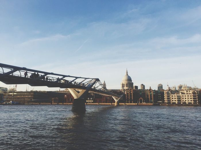 London Millennium Footbridge Over Thames River Against Sky In City