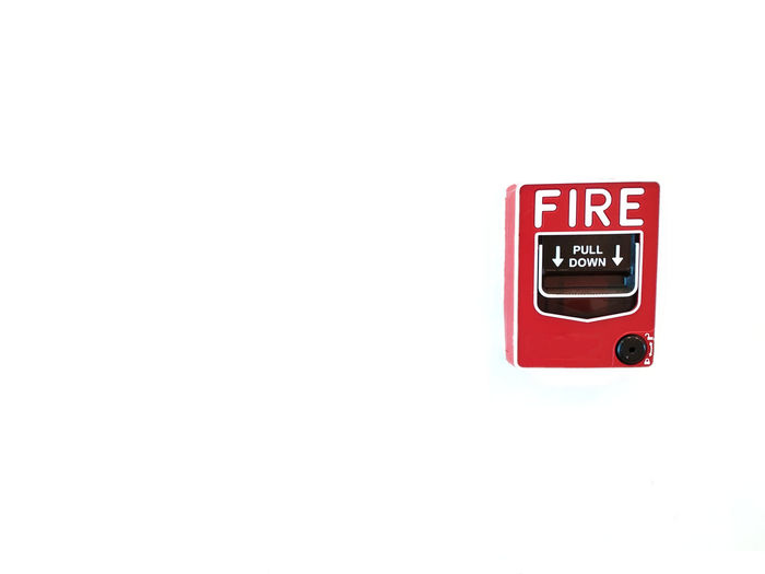 Accidents And Disasters Capital Letter Close-up Communication Copy Space Fire Alarm Indoors  No People Protection Push Button Red Safety Security Sign Studio Shot Technology Text Urgency Wall - Building Feature Western Script White Background