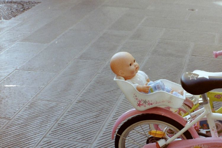 Toy Real People Real Life Baby Bike Childhood Analogue Photography Kodak Doll High Angle View Close-up