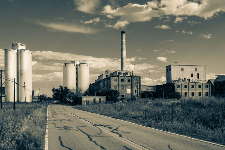 Abandoned old sugar mill factory in Longmont, Colorado, USA. Abandoned Abandoned Places Architecture B & W Photography Black And White Photography Blackandwhite Photography Building Building Exterior Built Structure Cloud - Sky Factory Industrial Industry Monochrome No People Sepia Smoke Stack Sugar Mill