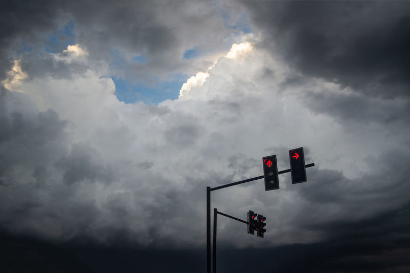 red light traffic with rainy clouds Beauty In Nature Cloud - Sky Communication Day Guidance Light Low Angle View Nature No People Outdoors Overcast Red Light Road Signal Sign Signal Sky Stoplight Storm Transportation