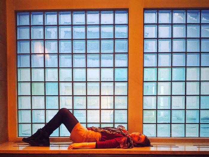 Woman sleeping on window