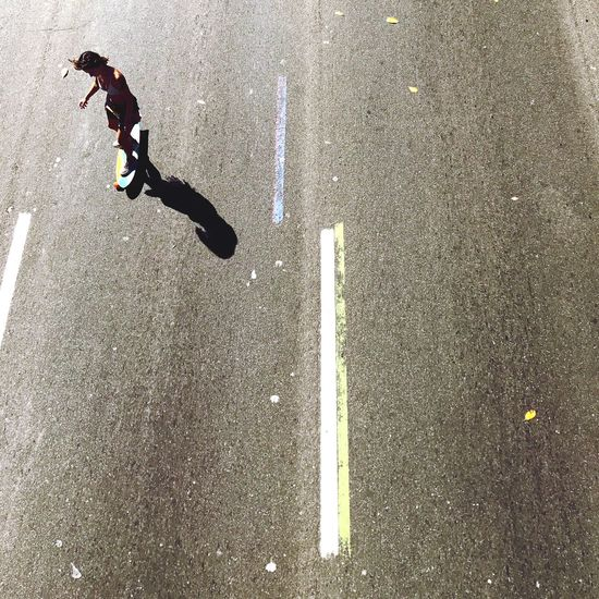 High Angle View Of Girl On Longboard