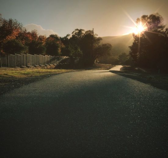 """The Way Home"" The late afternoon sun gently bathes an open space trail to home in its warm color and tone. Golden Hour Afternoon Sun Trail Path Dusk Sundown Sky Tranquility Beauty In Nature Sun Scenics - Nature Sunlight Sunset Road No People Lens Flare"