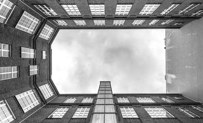 Black And White Krull&Krull Black And White Architecture Built Structure Building Exterior Building Low Angle View Sky Window Day Cloud - Sky Directly Below City Nature No People Outdoors Residential District Geometric Shape Pattern Glass - Material Office Building Exterior Sunlight Skyscraper Digital Composite Apartment