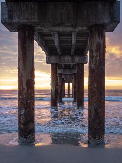 Under the Pier Beach Photography Beach Colorful Sky Colorful Sunrise Sunrise Florida Piers Florida St Augustine Florida St Augustine, FL St Augustine Pier Fishing Pier Water Sea Sunset Architectural Column Sky Pier Built Structure Horizon Over Water Architecture Underneath Beach Horizon Below Nature Outdoors Tranquil Scene