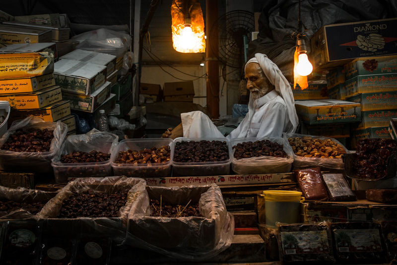 Arabic Bahrain Dates Food Food And Drink For Sale Freshness Gulf Healthy Eating Indoors  Market Market Stall Middle East Night Old Man Old Market One Person People Real People Retail  Tradition Traditional Traditional Culture Variation Women Connected By Travel