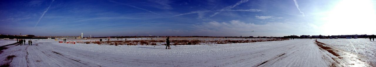 Panoramic View Of People Walking On Snow Landscape