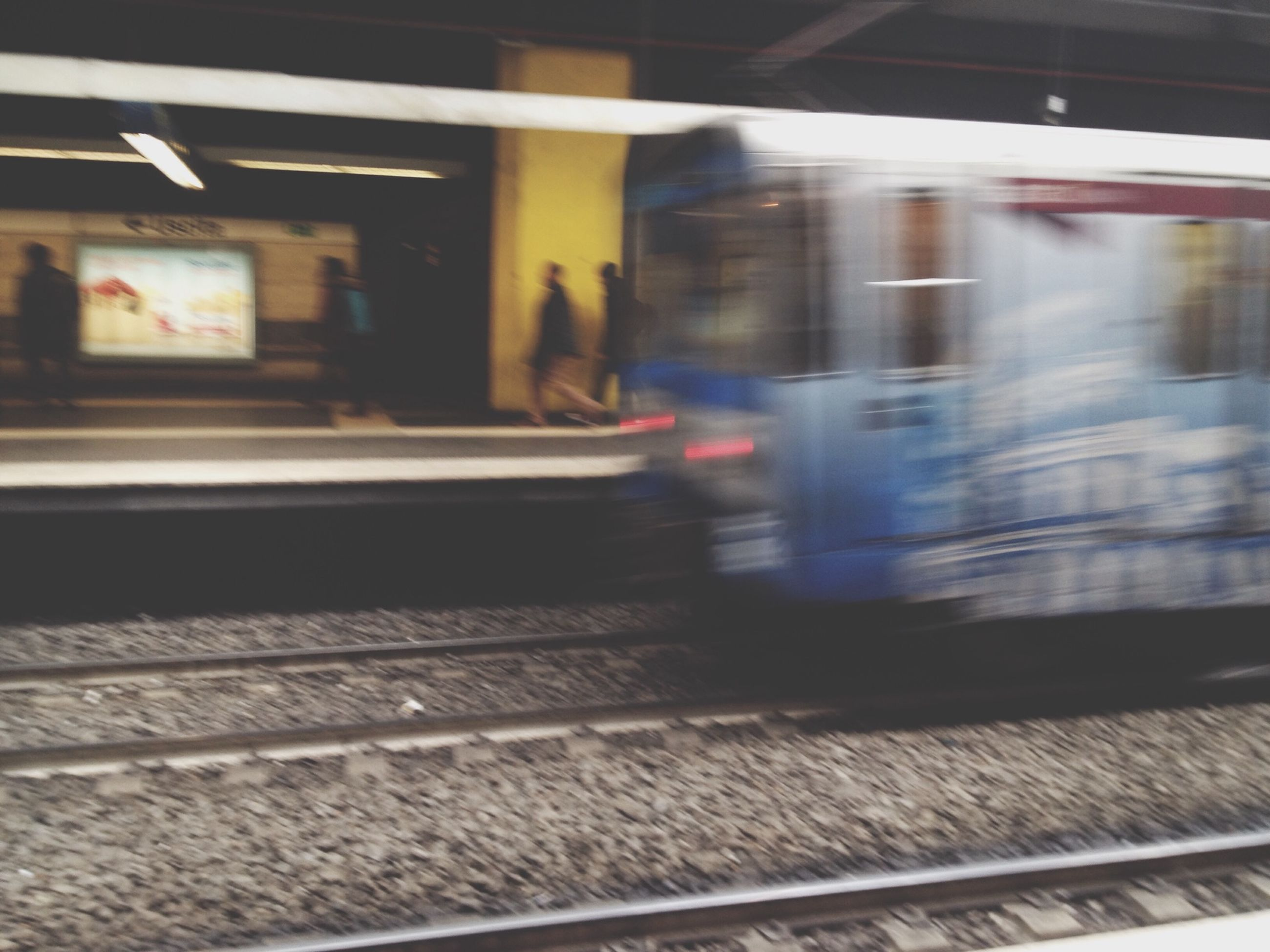 transportation, public transportation, railroad station platform, railroad track, rail transportation, railroad station, mode of transport, train - vehicle, travel, blurred motion, motion, passenger train, indoors, on the move, speed, subway station, train, illuminated, public transport, subway train