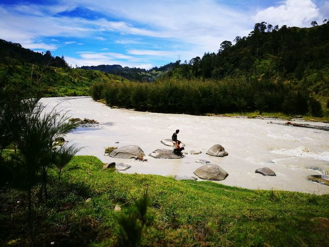 EyeEmNewHere Real People Nature Outdoors Trees And River Beauty In Nature Mountains And Sky Two People Fishing Riverbank Green Grass Bluesky Clear Sky Nature Photography Beautiful View Rural Life Rural Life In Papua New Guinea.. Two Boys