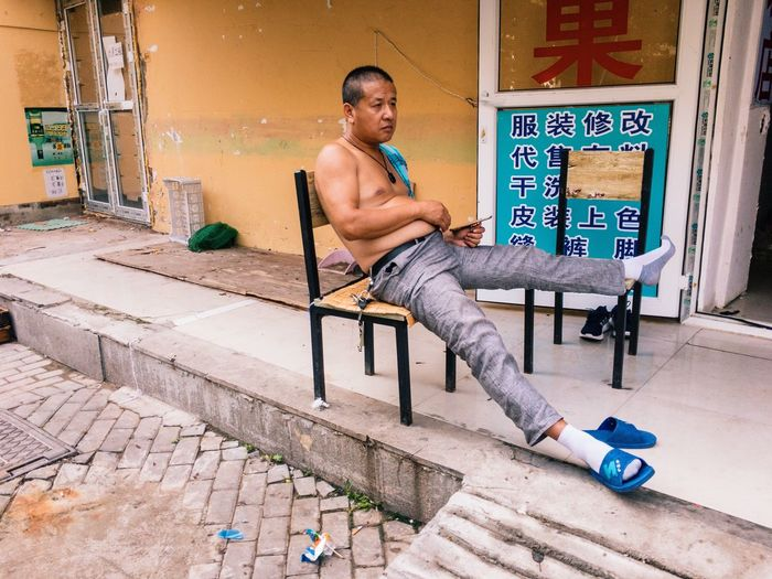Dalian, Liaoning, China 2017 MelbournePhotographer IPhoneography Mobilephotography Streetphotography Adobelightroommobile Vscocam Sitting Shirtless Full Length One Person Young Adult Real People Outdoors Day Portrait One Man Only People Only Men Adult Adults Only