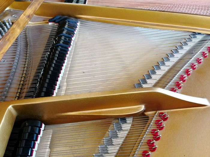 Grand piano brown interior Grand Piano Grand Piano Interior String Instrument Music Backgrounds Music Festival Music Background Theme EyeEm Selects High Angle View Close-up Musical Instrument String Bow - Musical Equipment Keyboard Instrument Soloist Pianist Musical Equipment