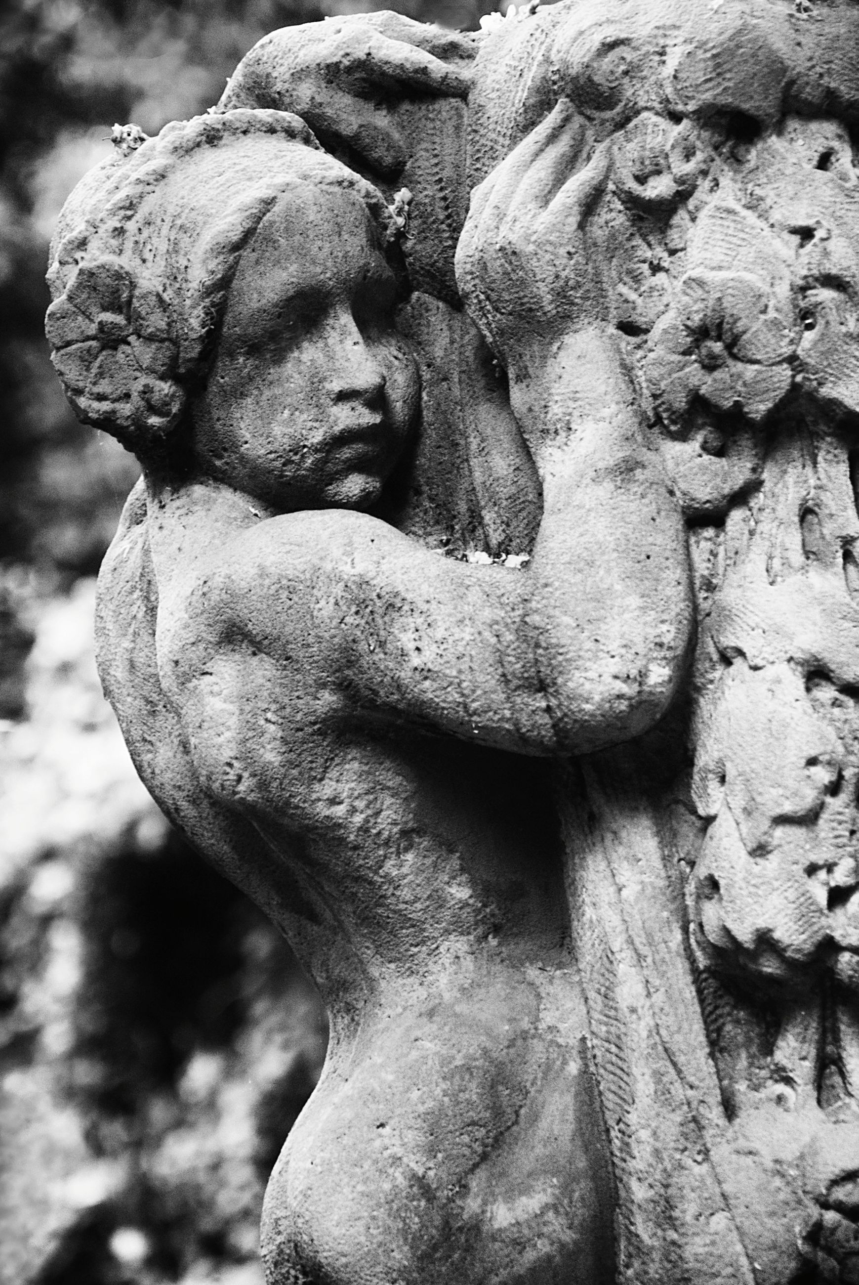 sculpture, statue, human representation, art, art and craft, creativity, close-up, focus on foreground, carving - craft product, outdoors, day, tree, stone, no people, nature, weathered, low angle view, animal representation, old